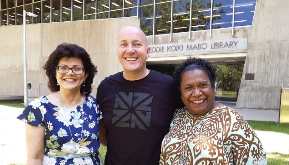 Helen Hooper, Rob Douma, and Gail Mabo smile while standing in front of the Mabo Library