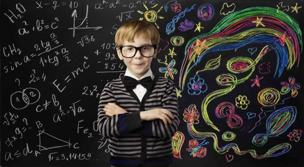 child standing in-front of chalk board
