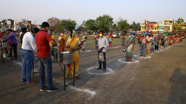 People queue for food in India during Covid-19 pandemic