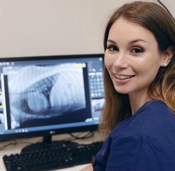 Brooke at computer looking at an x-ray