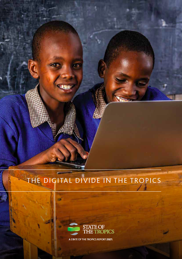 Cover image of The Digital Divide in the Tropics. Two boys in Kenya sit at a desk with a computer
