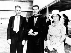 Our first graduate - John Hayes following the graduation ceremony at the Pimlico site of the University College of Townsville in 1964.