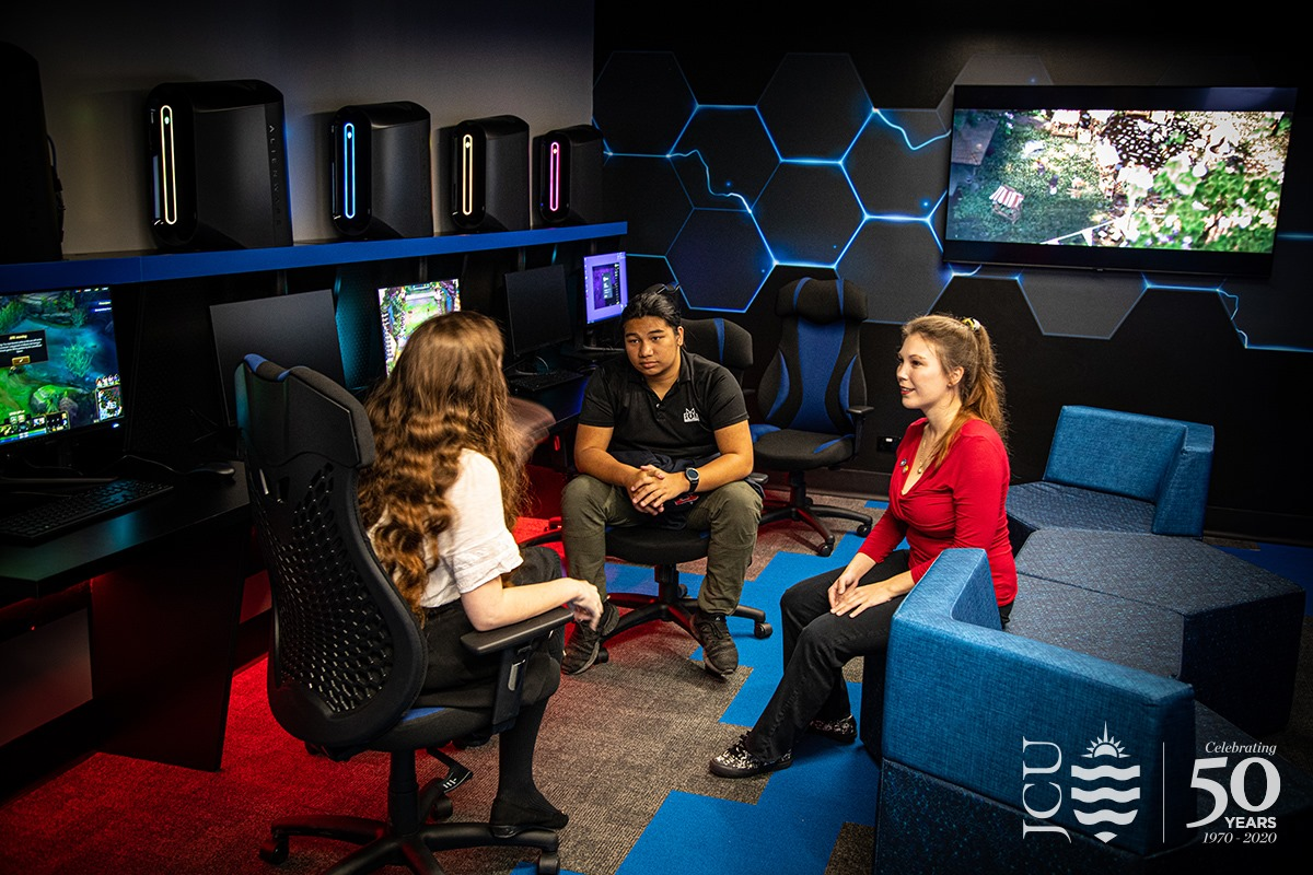 3 students chatting in the JCU eSports room