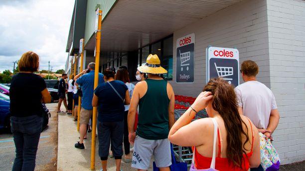 People queue to enter supermarket in Australia