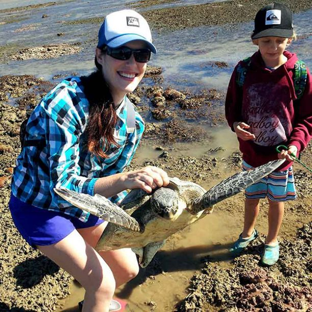 Melanie Meaglia with son rescuing turtle