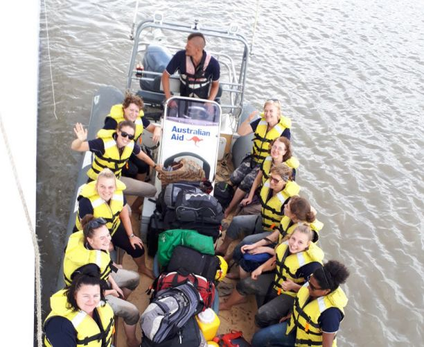 Nursing students in a boat to deliver healthcare to remote communities