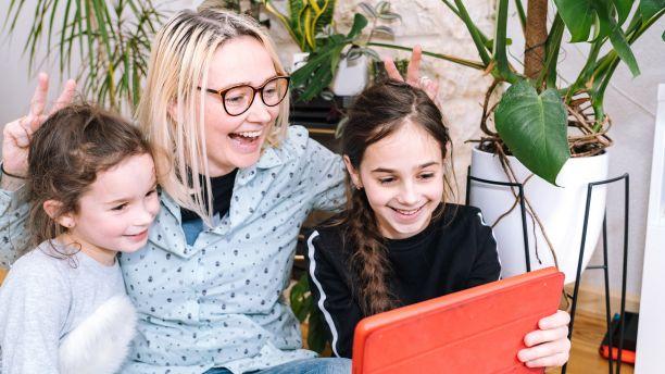 Family talking on tablet