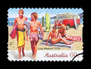 Postage stamp showing surfers in 1970s Australia