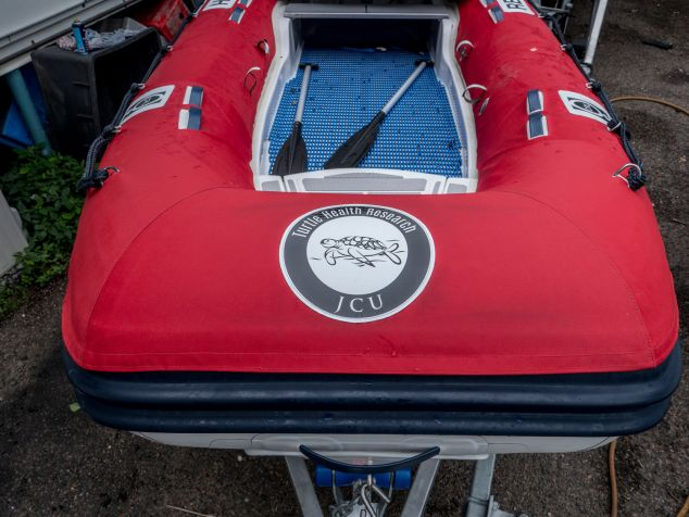 The turtle health research logo on a red boat