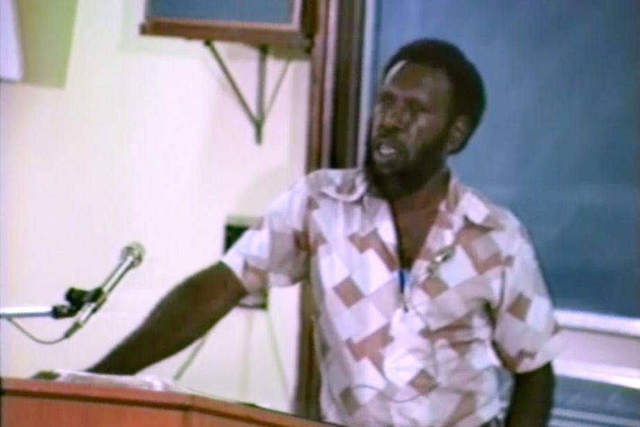 Koiki Mabo stands at a lectern, talking
