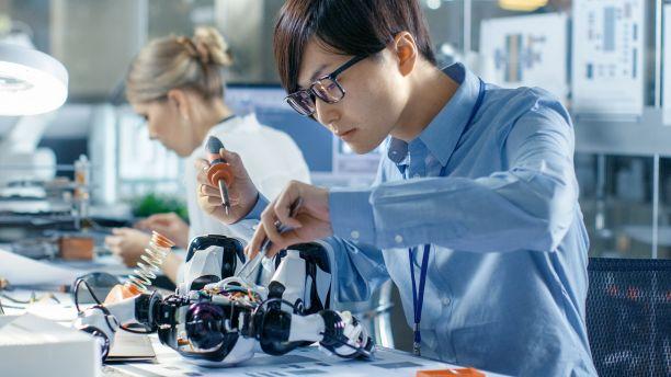 Electronics engineer soldering robot