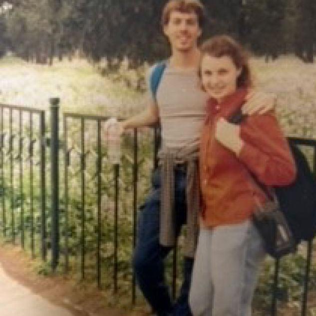 Richard Anderton next to his sister Sarah and they are both standing on front of a field