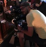 Man filming on camera.