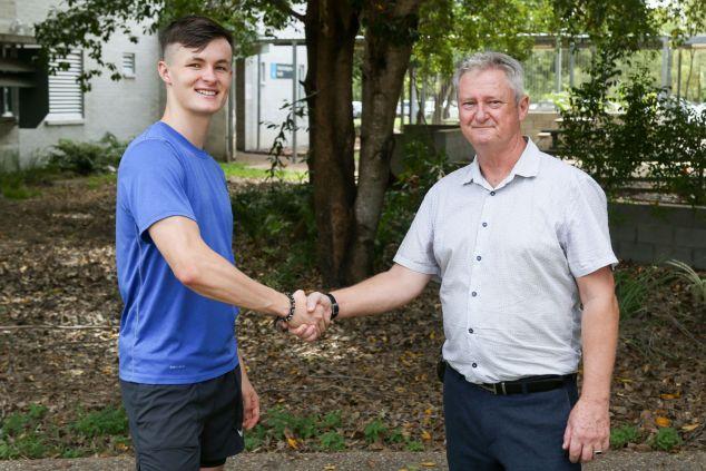 Jake Doran shakes hands with Prof Chris Cocklin