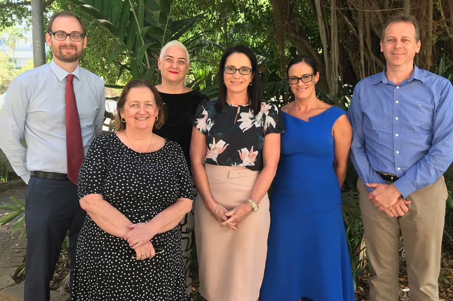 6 members of JCU Connect staff stand in a group