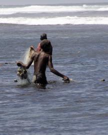 man fishing with hand net.