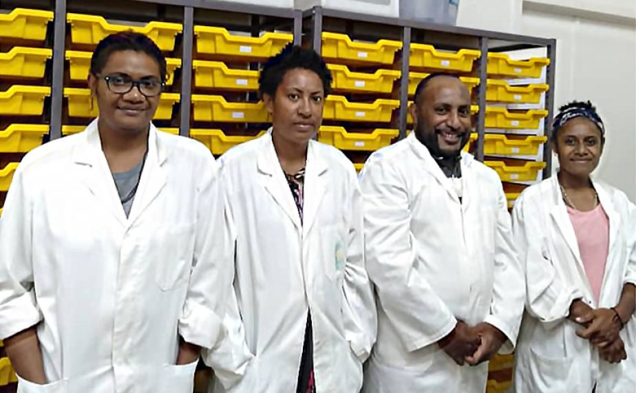 Researchers in lab coats