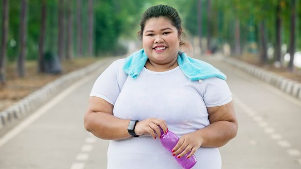 obese woman exercising