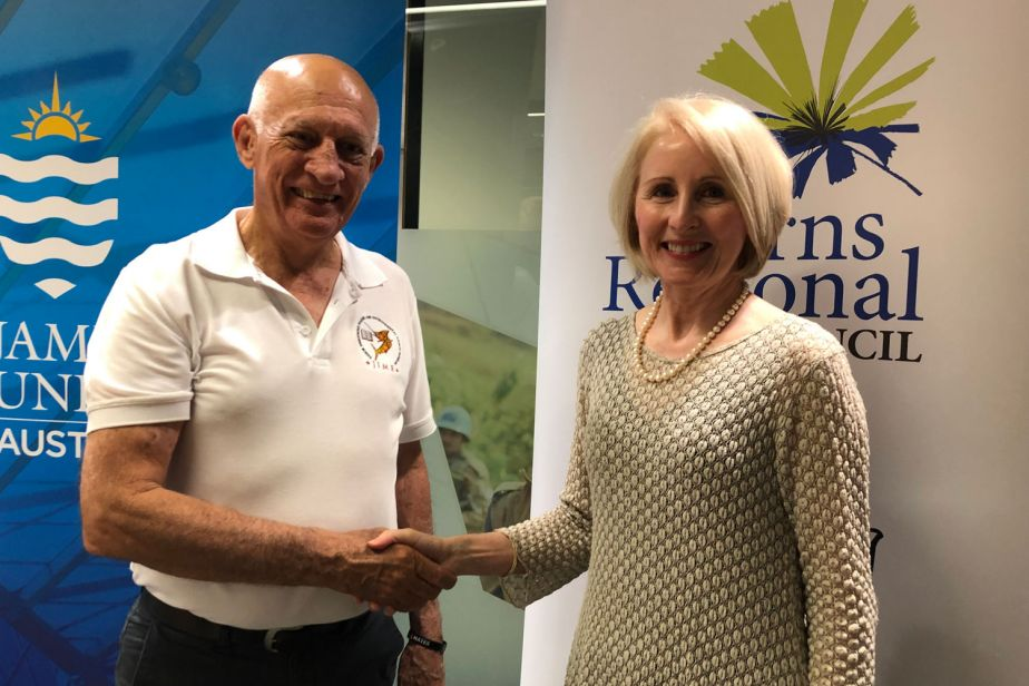 Vice Chancellor Sandra Harding shakes hands with Cairns Regional Council Mayor Bob Manning