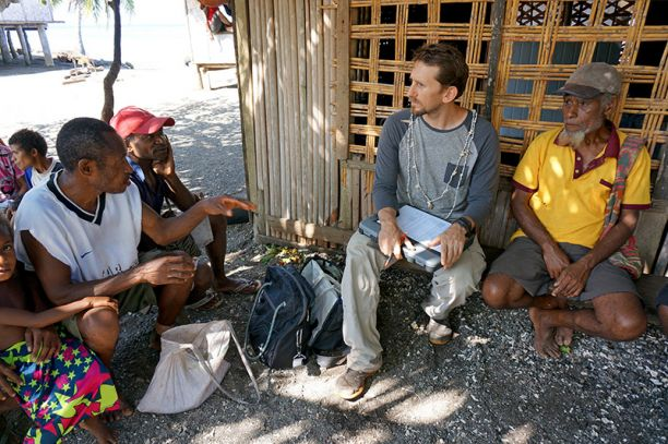 Josh Cinner talking with a group of Papua New Guinean fisherman