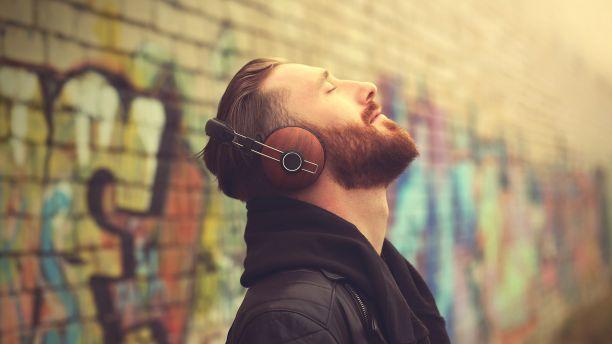 Man wearing headphones listening to music