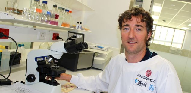 Dr Andreas Kupz in his lab