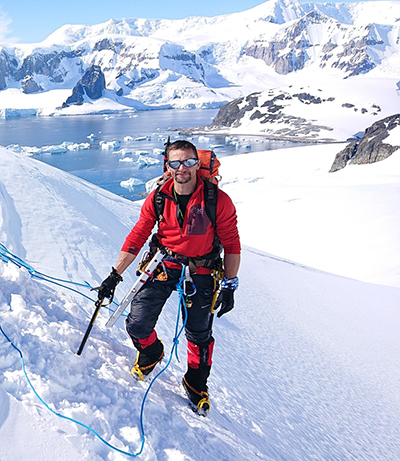 Callum Blackhall on a hike in Antarctica in 2019