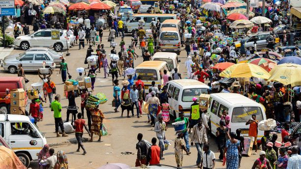 Busy street in Ghana with cars and people sharing the road