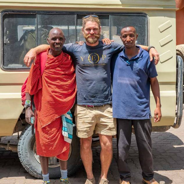 Shane Ross pictured with two local men in Africa