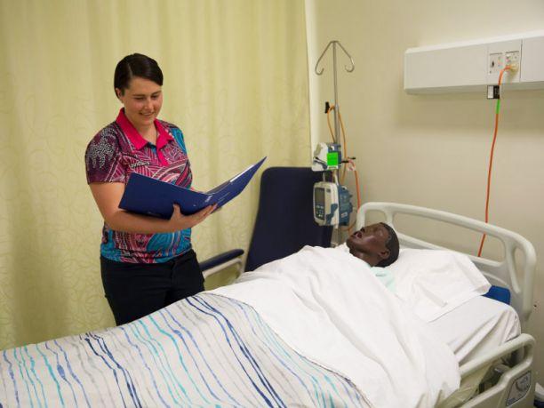 Nurse graduate Emily Hapgood training with patient model