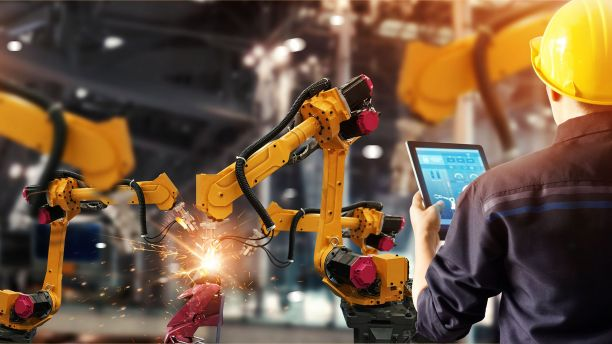 Engineer working with industry robots