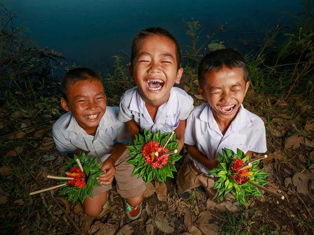 Three cambodian boys smiling