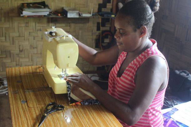 A woman on Dorothy's team sewing a hygienic pad