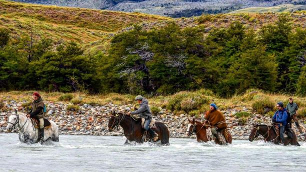 Dr Campbell Costello riding a horse across Patagonia for the Gaucho Derby.