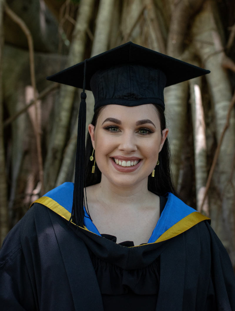 A portrait of JCU Speech Pathology graduate Brittany Vella in her Honours gown and mortar board.