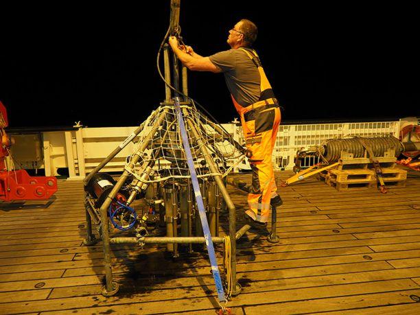 Crewmember prepares the underwater camera