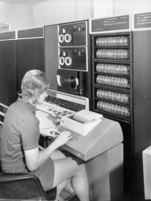 A staff member using the PDP 10 computer