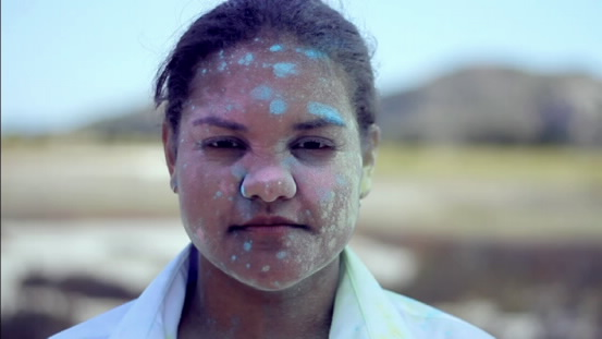 Carmen Smith with paint on face.