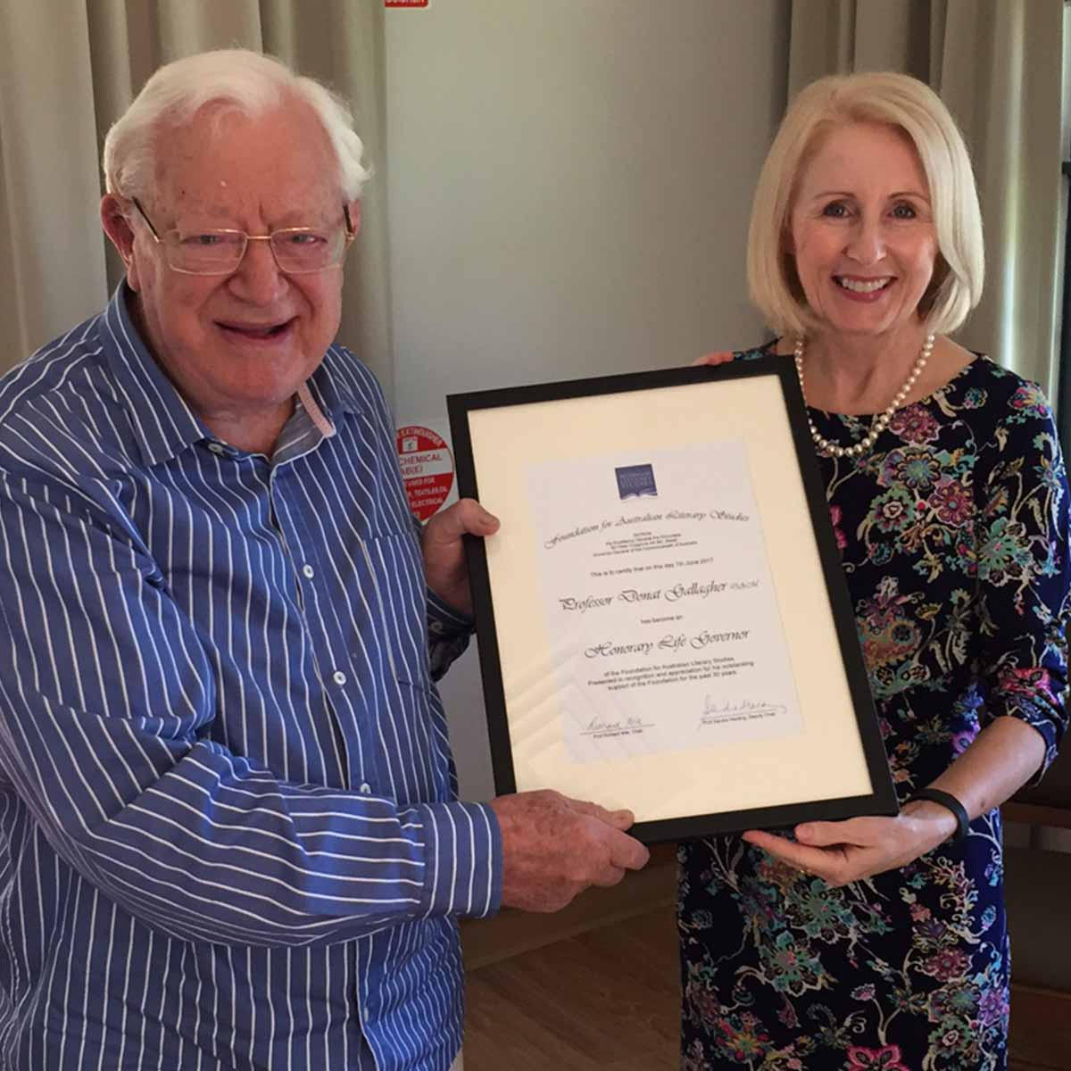Prof Don Gallagher receiving Life Governors certificate with Prof Sandra Harding