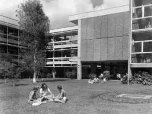 Students talking on the grass at A Block