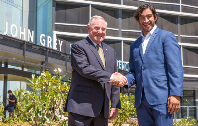 John Grey and Johnathan Thurston shaking hands in front of John Grey Hall
